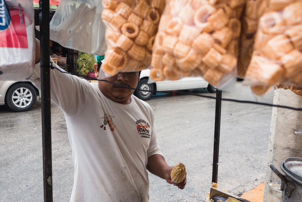 Man preparing corn street food