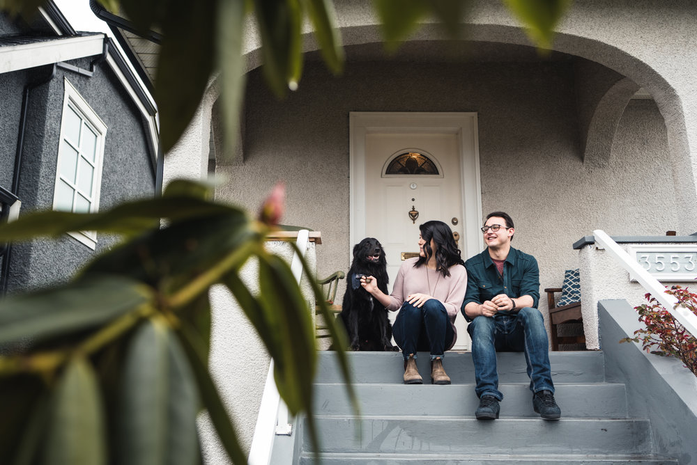 Couple on front steps with dog