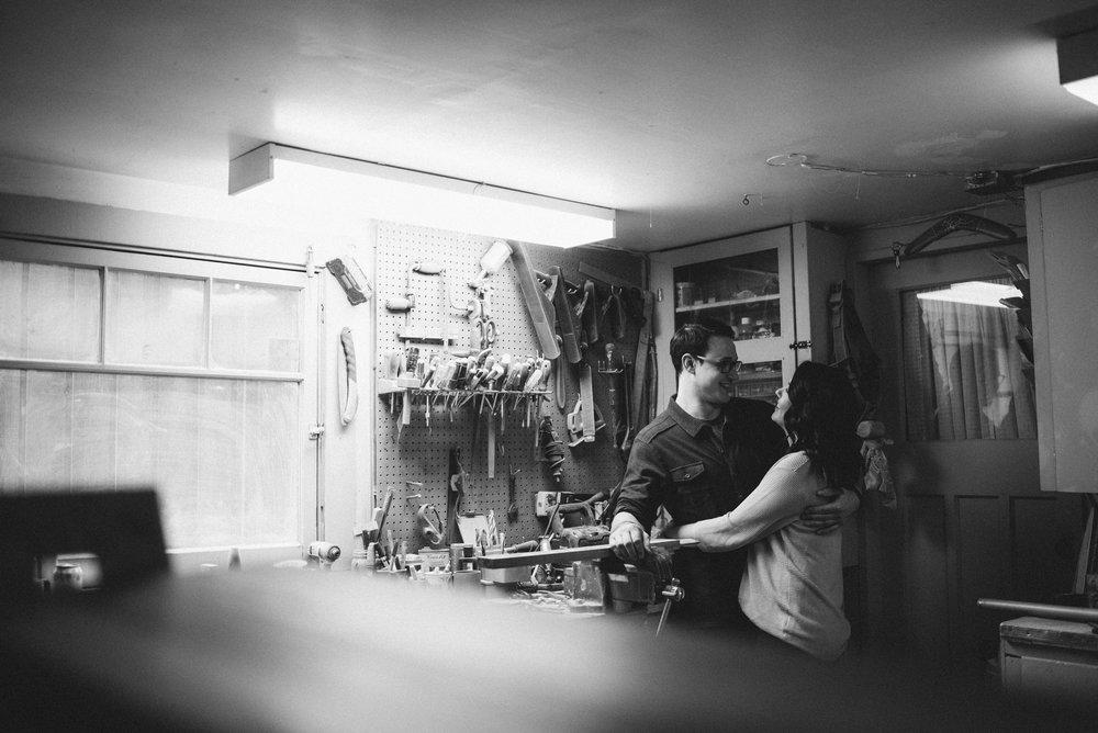 Couple hugging in workshop