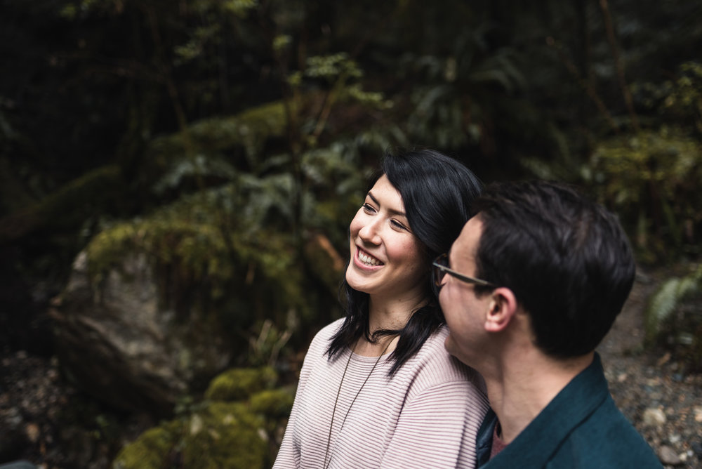 Couple smiling in forest