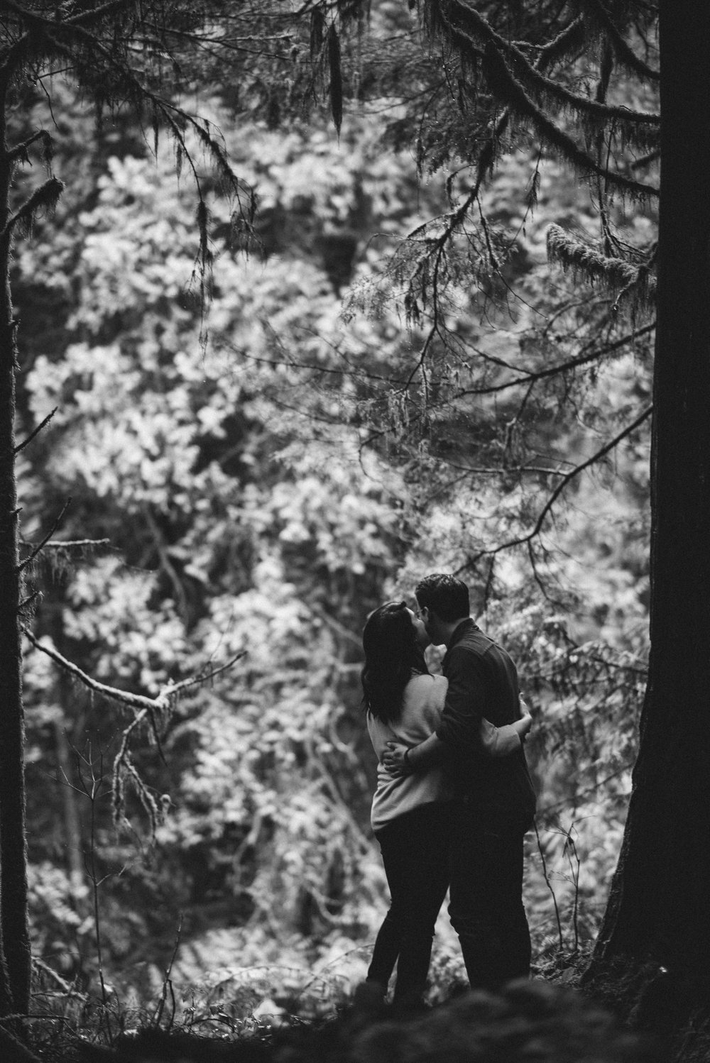 Couple embracing in forest black and white
