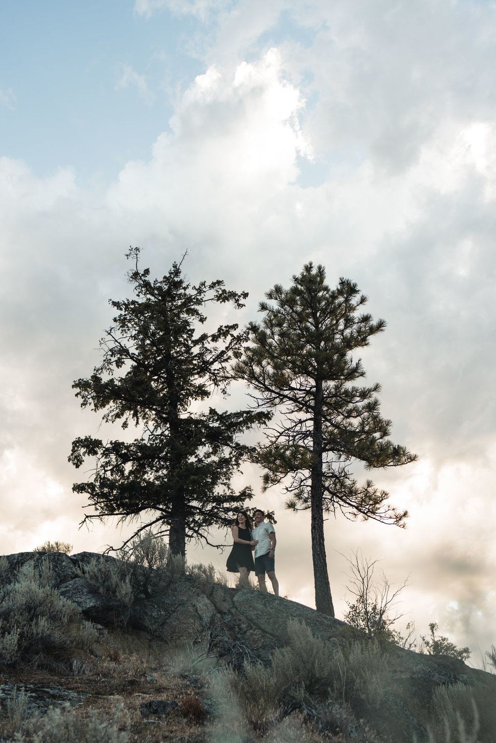 Couple poses with trees on Anarchist Mountain, Osoyoos