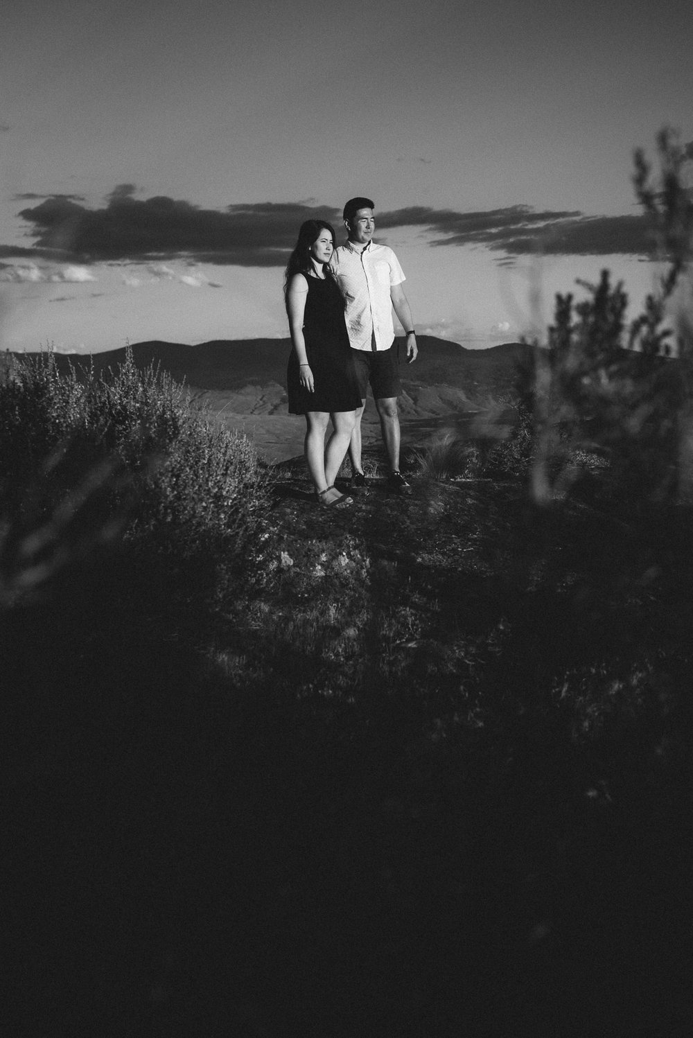 Engaged couple poses with sunset on Anarchist Mountain, Osoyoos