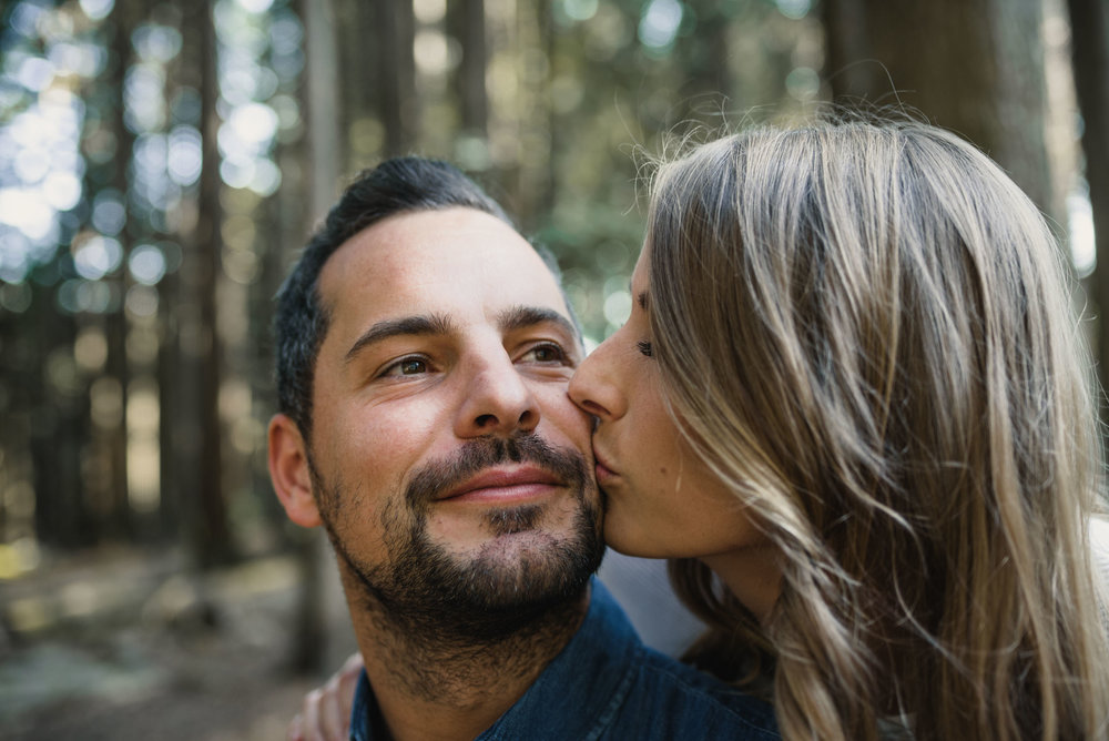 Couple kisses in the forest