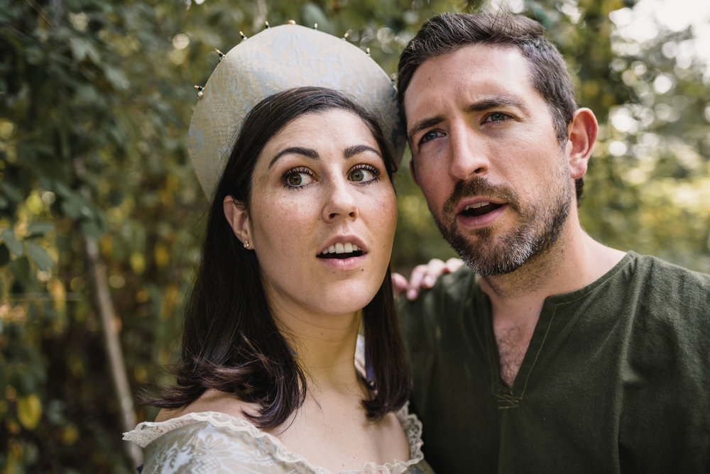 Shocked looking couple with medieval costumes