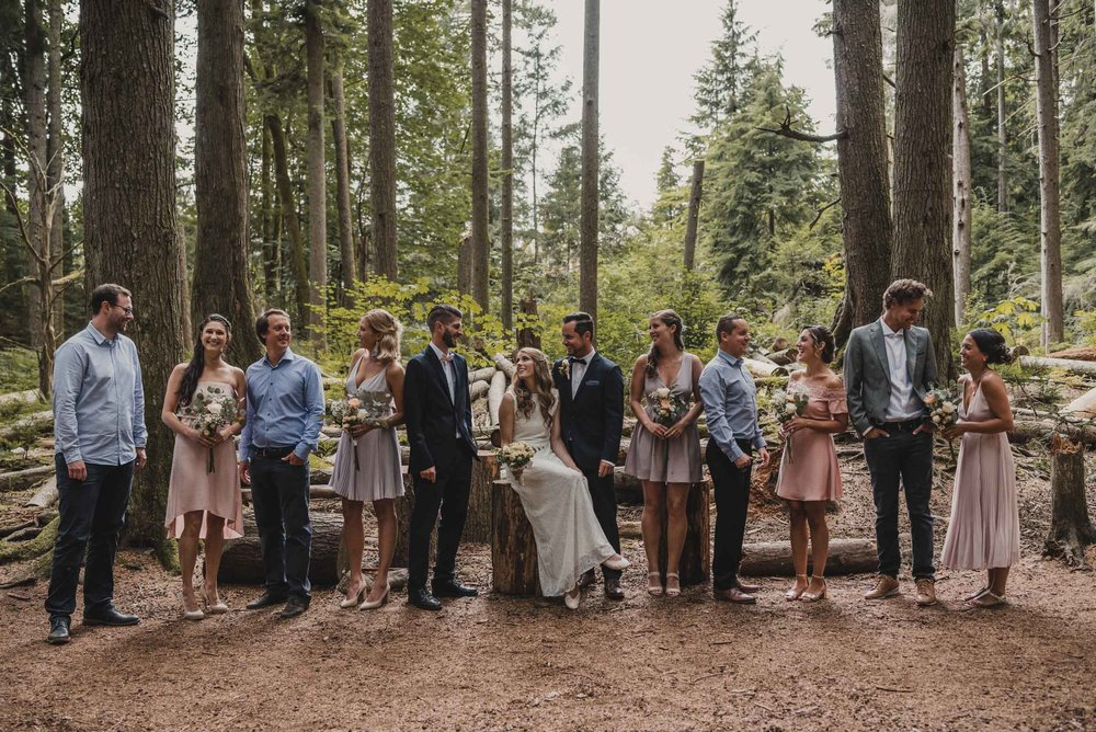 Wedding party group photo in forest