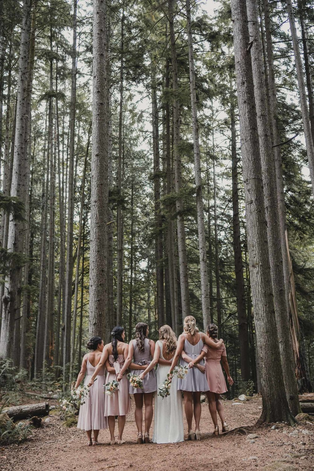 Bride and bridesmaids in forest