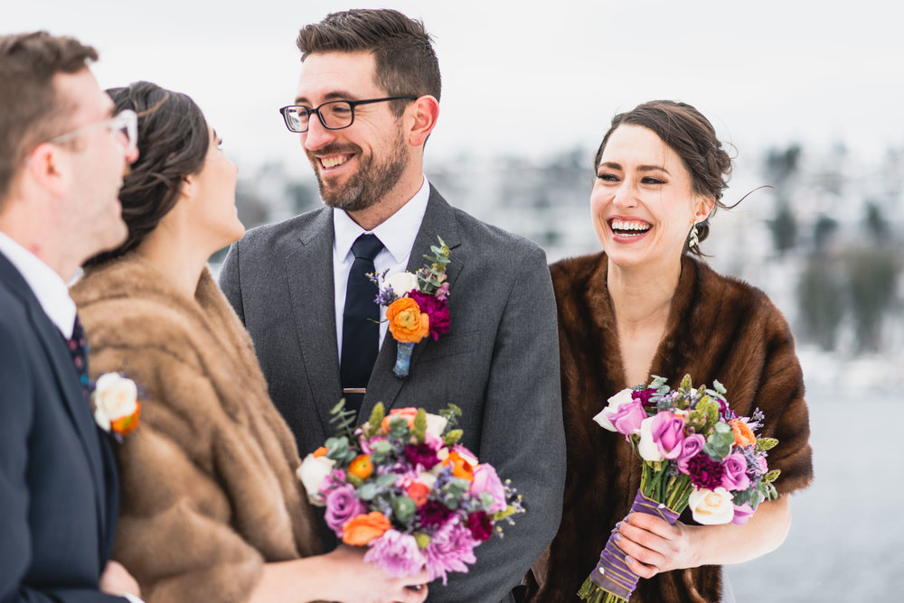 Bridal party laughs together