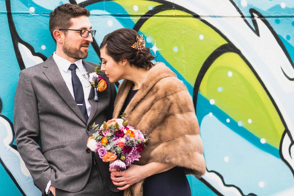 Bride smells Groom's boutonnière