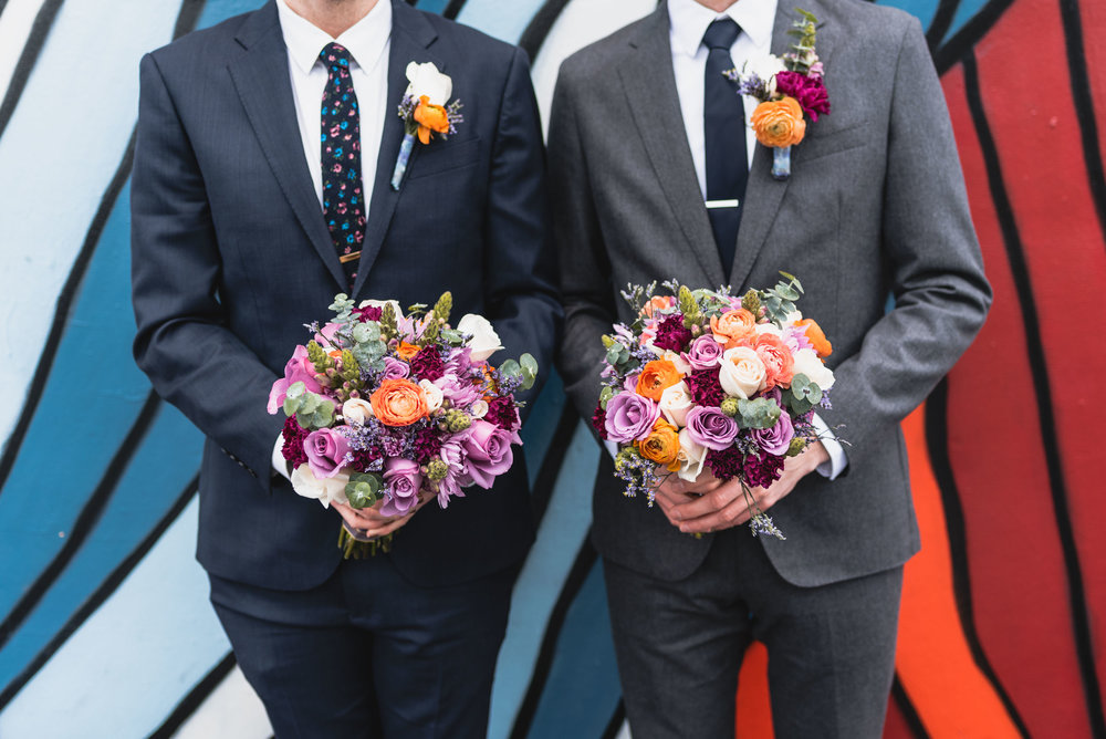 Groom and Best Man hold flowers