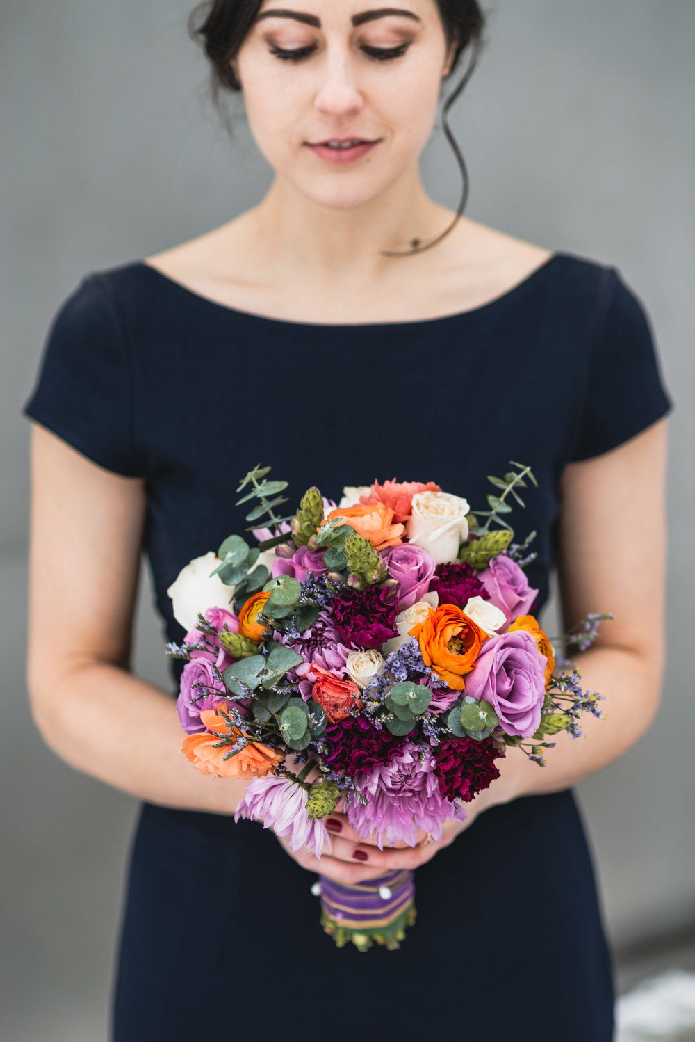 Bride holds bouquet of flowers