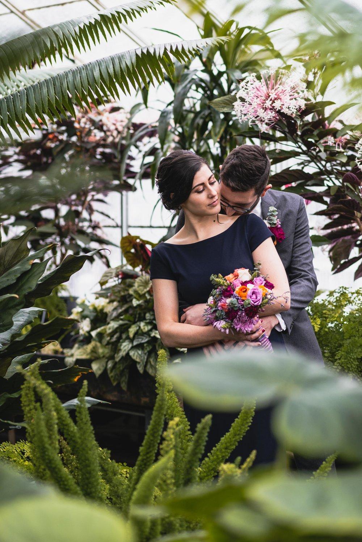 Bride and groom among plants