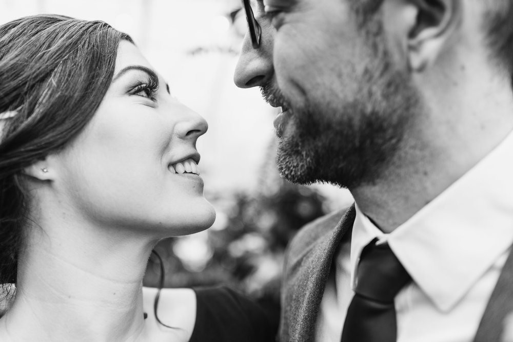 Bride and Groom smile at each other