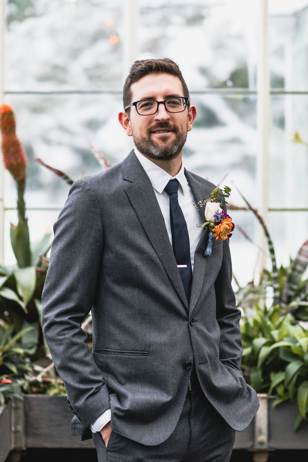 Groom portrait in conservatory