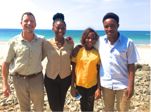 THANE KREINER (LEFT) OF MILLER CENTER WITH WEST AFRICAN SOCIAL ENTREPRENEURS (LEFT TO RIGHT) DAVEPHINE THOLLEY, JASONTA COKIER AND SAMUEL NONIE IN JANUARY.