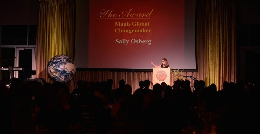 SALLY OSBERG OF THE SKOLL FOUNDATION ACCEPTS THE 2014 MAGIS CHANGEMAKER AWARD