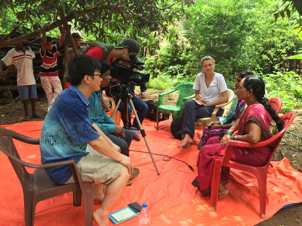 Erika Francks (third from left, in white blouse) conducting an interview in a village served by ONergy (West Bengal, India).