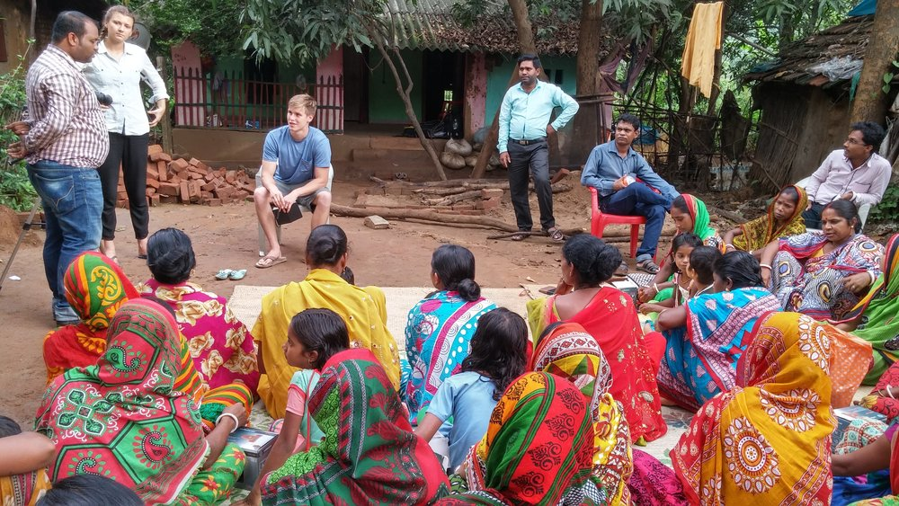 Erika Francks (second from left, standing) and Carson Whisler (third from left, sitting) participate in a village interview with ONergy staff (west Bengal, India).