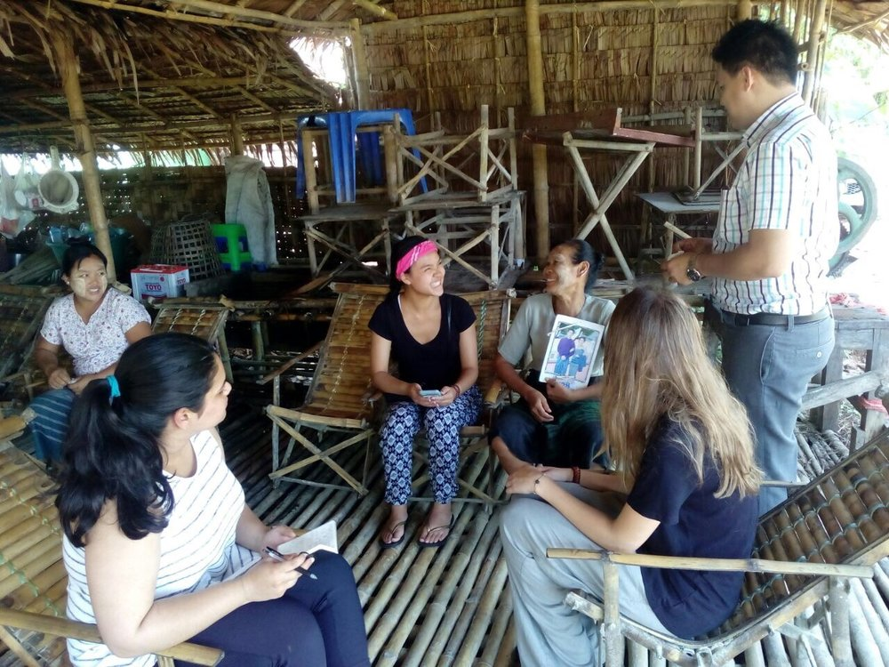 Esther Bartlett, Athena Nguyen (center), and Aung Nyein Chan, Koe Koe Tech's Marketing Manager, conduct interviews (rural Twante Township, Myanmar).