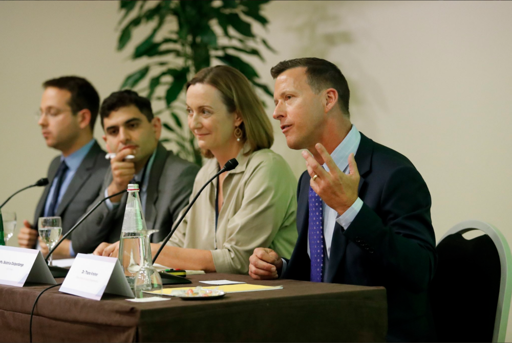 Miller Center Executive Director Thane Kreiner lead a panel on using impact investing to help solve global problems of human trafficking, migrants, and refugees.