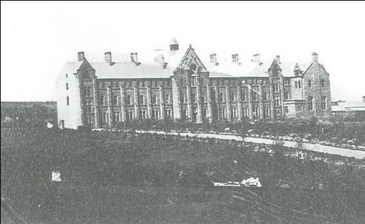 The original college, photographed in 1883 (front)