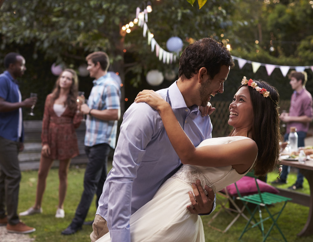 young-couple-celebrating-wedding-with-party-in-PBG3FHM.jpg