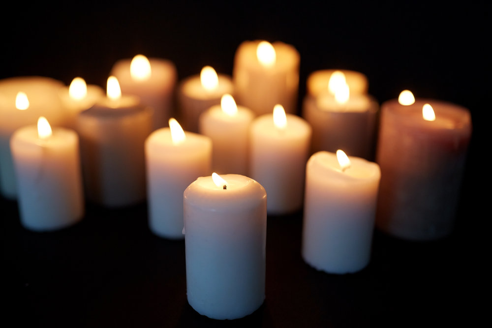 candles-burning-in-darkness-over-black-background-P355AF3.jpg