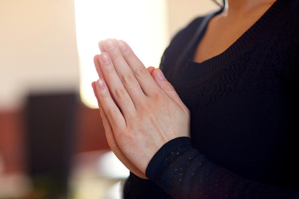 close-up-of-sad-woman-praying-god-in-church-PCX8XK6.jpg