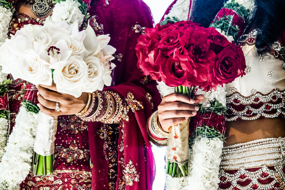 two-indian-wedding-bouquets-and-brides-PEHTYDK.jpg