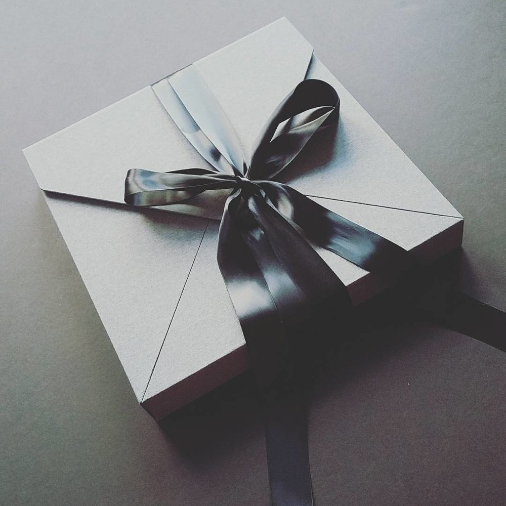This is one of two folio boxes I offer. Imagine unwrapping this long silk ribbon and opening the envelope style box to show off your beautiful 11X14 matted prints.