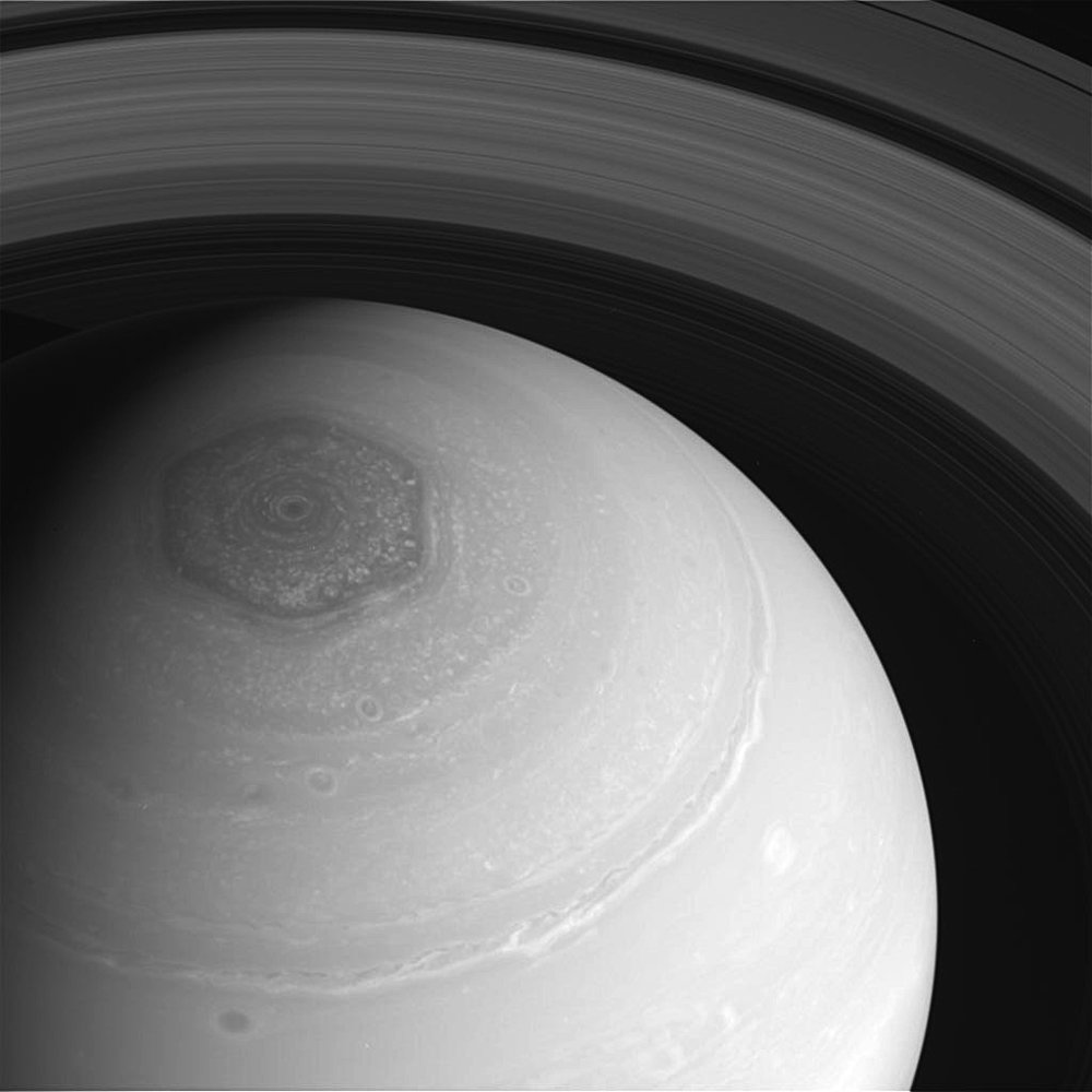 A hexagon shape can be seen atop the planet Saturn