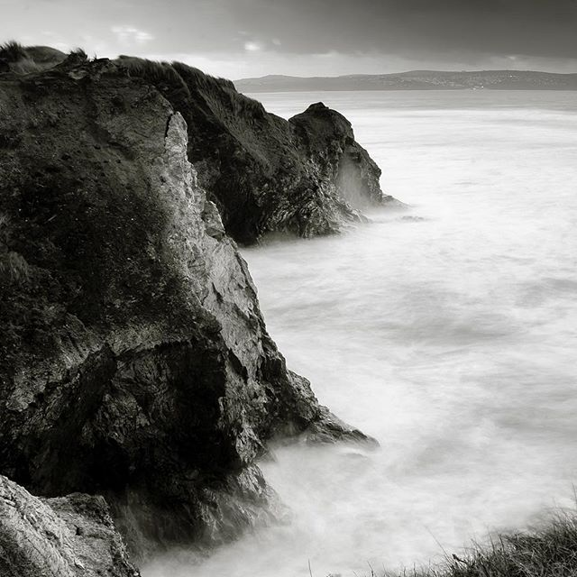 A beautiful black & white photo of Gwithian cliffs, Cornwall, England.  F/22, ISO 300, shutter 30s, Nikon D7000  #longexposure #cornwall #gwithian #nikon #stock photography #blackandwhite