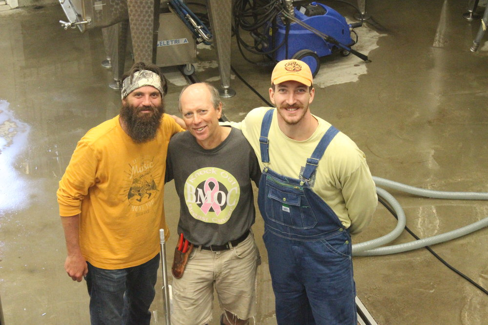 Dodon's new assistant winemaker Seth McCombs (left), Tom (middle), and BJ (right), harvest intern, prepare for bottling.