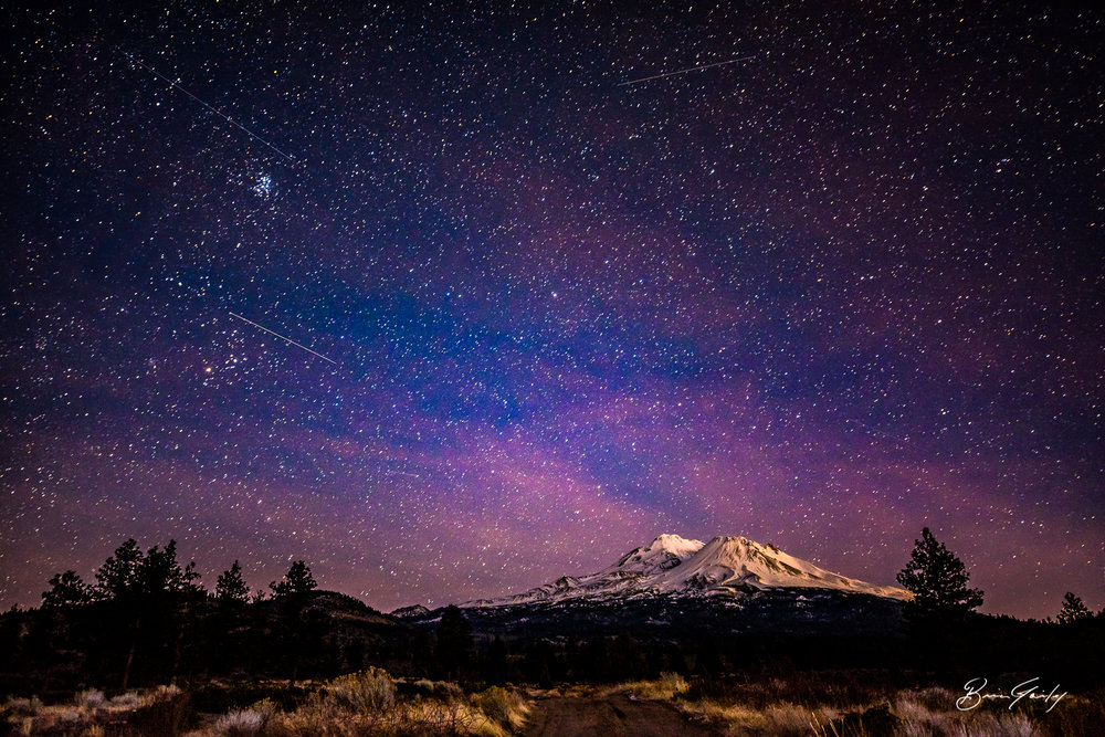 Airplanes streak across the night sky. Mount Shasta, California.