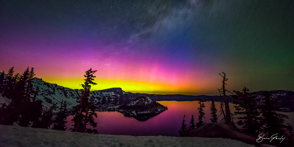 A glow of rainbow colors as the Aurora Borealis was visiable from Crater Lake NP on May 28, 2017. BrianGailey.com