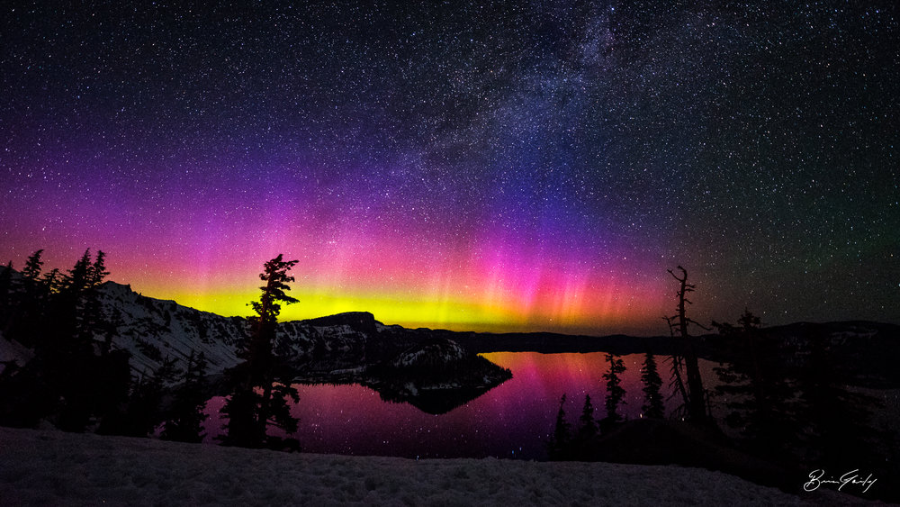 Verticle bands of color and light can be seen emited from the Northern Lights above Crater Lake, OR. BrianGailey.com