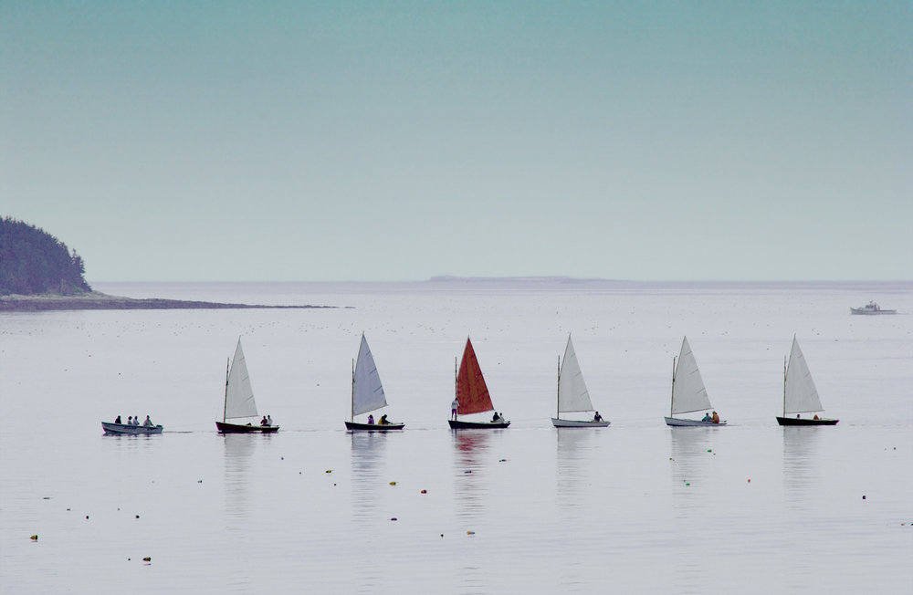 """becalmed """"cats"""" towed home"""