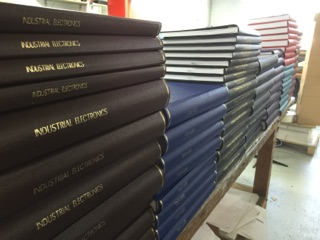 CASE STUDY: Organisational Binding Chishom Tafe contacted us in December 2016 to assist in a 'few' books to be hard case bound for their new initiative in partnership with Vietnam. Following the initial discussion, it was calculated the college required over 120 books in various colors, sizes and formats, to be ready for shipment by mid Jan 2017
