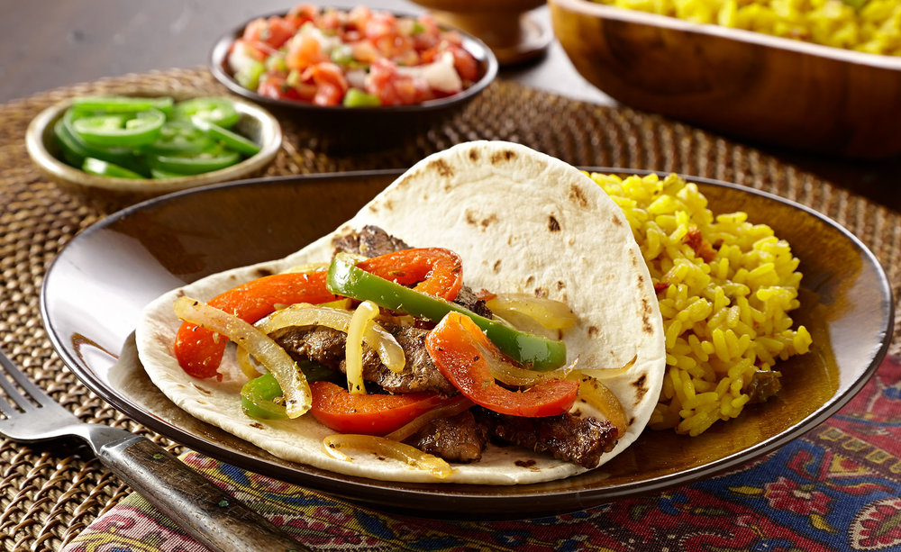 Fajitas - option of beef, chicken, or tofucorn or flour tortillasfinishing it off with mexican rice, and black bean corn