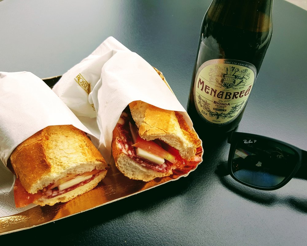 Fresh salami, cheese, tomato on a baguette & an Italian beer