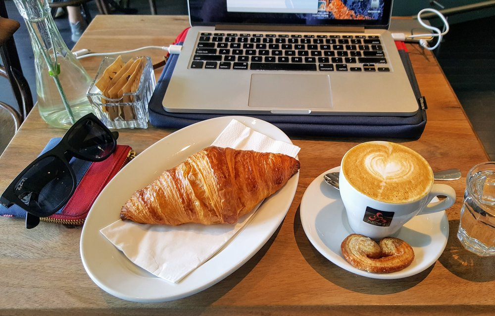 Warm croissant & cappuccino from Franzos