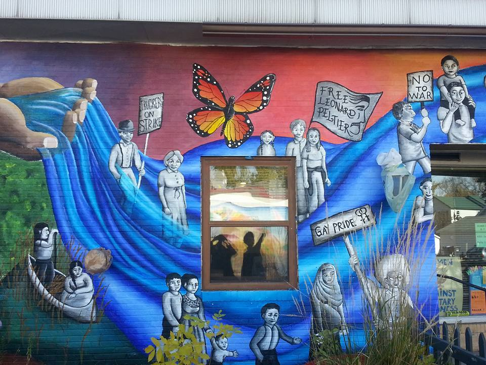 Mural of 4200 Cedar, home to WAMM and other peace and justice organizations.