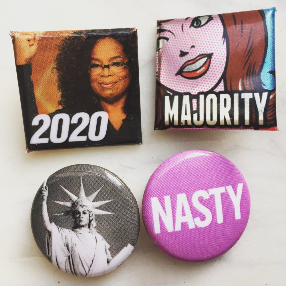 Buttons Matt designed and passed out at the march.