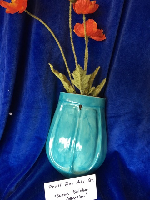 Item #32  Beautiful and whimsical vases hold brightly colored flowers to complement the wall in any room by Susan Balshor