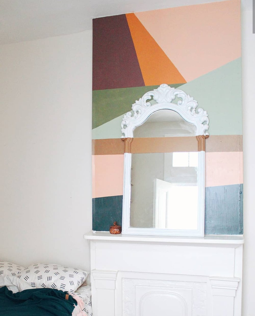 Simple color blocking with a strip of paint across the mirror. Little details that can make a space unique.
