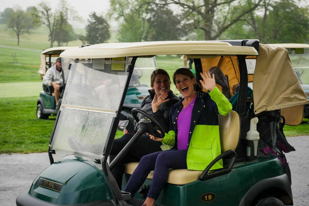 Millennial members Jessica Clarkson & Courtney Hunter Godsey participating in our signature golf tournament fundraiser.