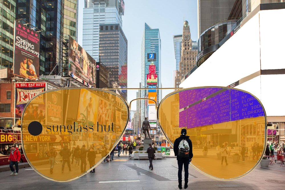 Times Square with Sunglass Hut Polarized Lenses using LCD technology to give the address to Attaboy Speakeasy