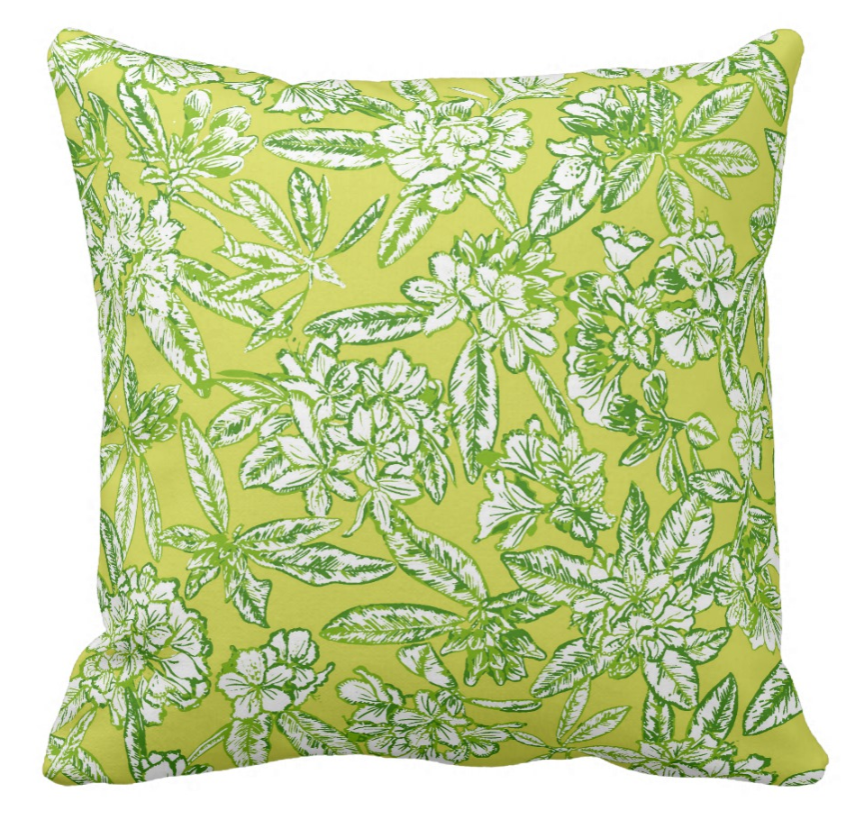 yellow, green and white floral patterned throw pillow