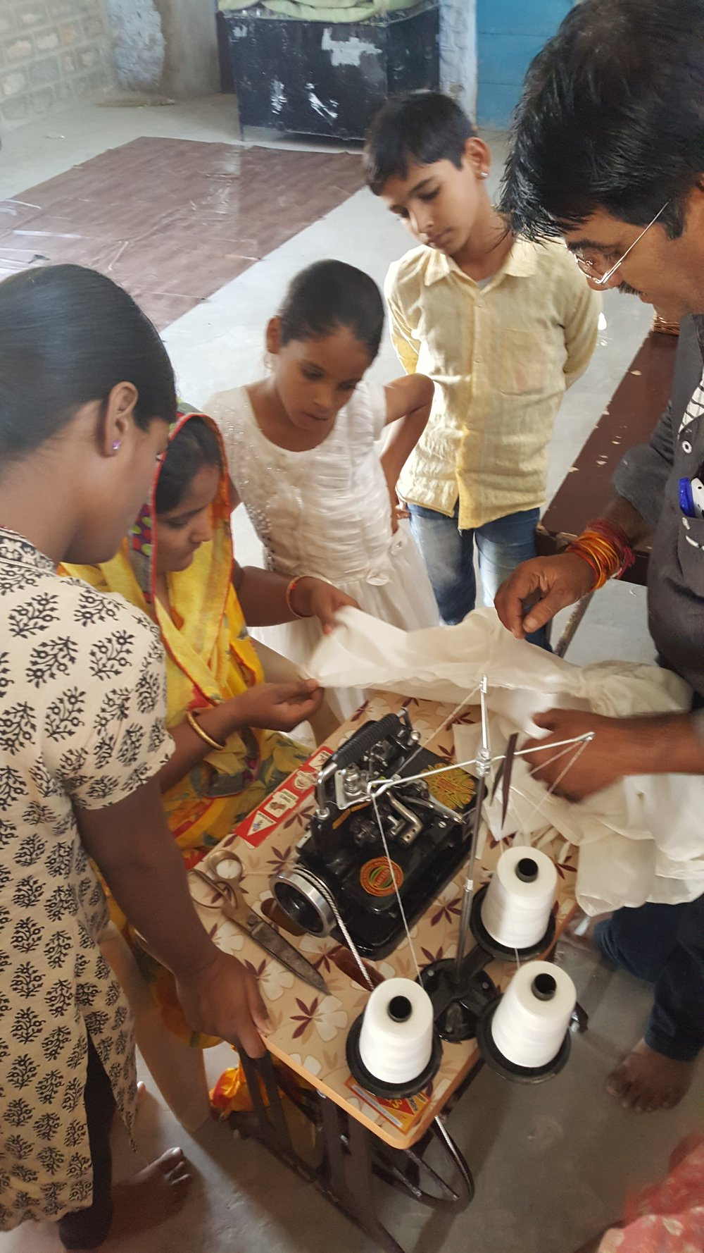 Saheli women learning new machine