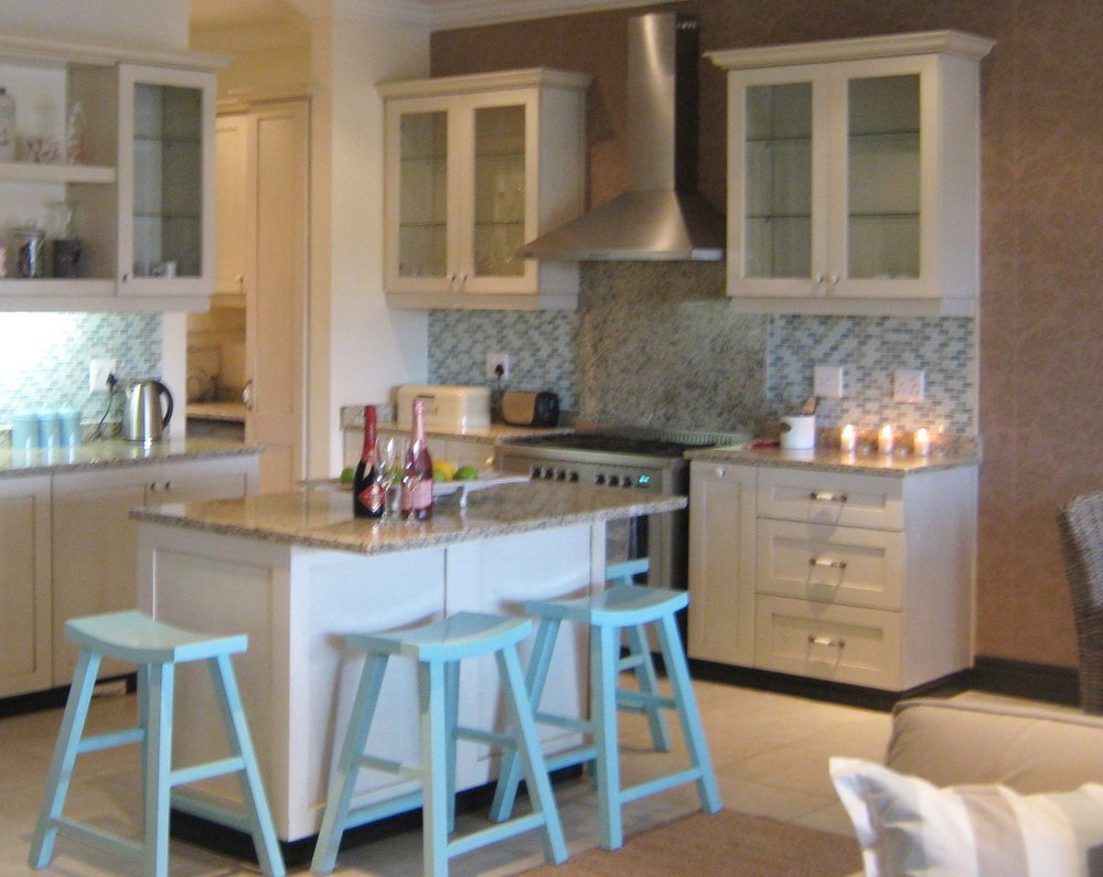 Splashing out a little on the mosaic tile turned this kitchen from drab to fab!